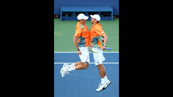 U.S. players Bob Bryan and Mike Bryan chest bump after winning match point in their men