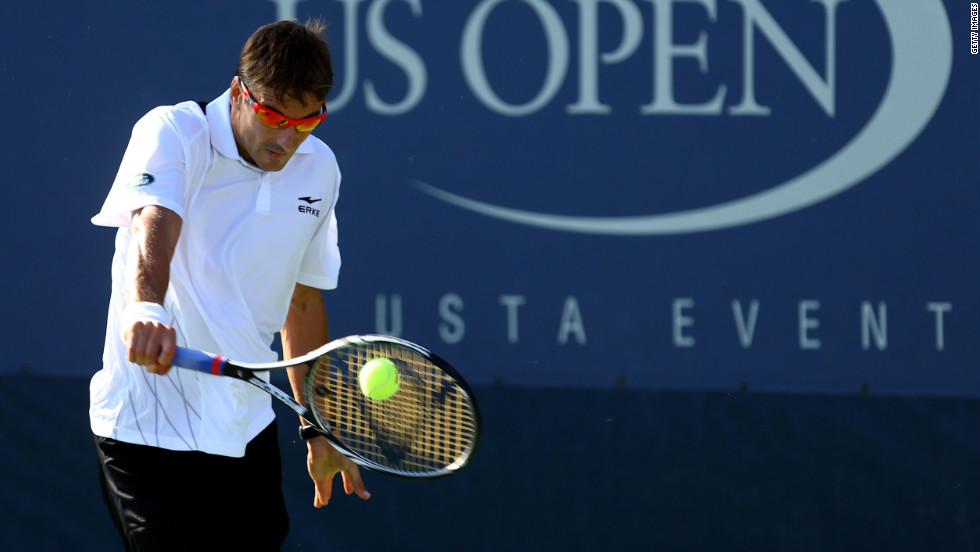 Spain's Tommy Robredo poaches the ball during his men's singles first-round match against Italian Andreas Seppi.