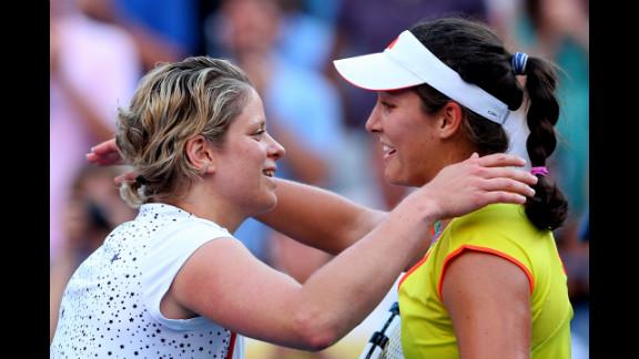 Belgian Kim Clijsters, left, congratulates Britain