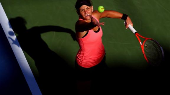 Australian Casey Dellacqua serves against China