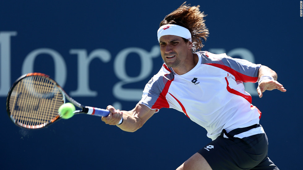 Spain's David Ferrer returns a shot against South African Kevin Anderson.