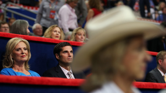 Mitt Romney's wife, Ann, and son Josh sit in the VIP box.
