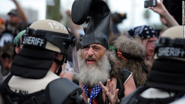 25548438784 Protester Vermin Supreme talks with riot police at the Republican National  Convention in Tampa on Tuesday