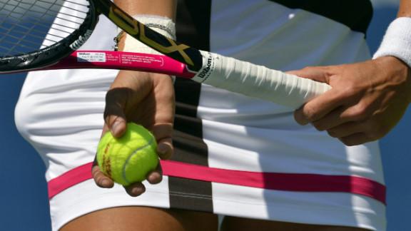 Varvara Lepchenko of the United States returns against Samantha Stosur of Australia.