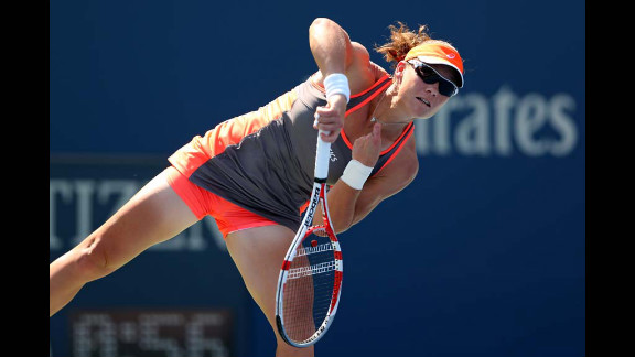 Samantha Stosur of Australia serves against Varvara Lepchenko of the United States during a women