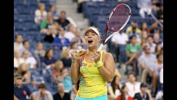 Angelique Kerber of Germany celebrates match point after her women