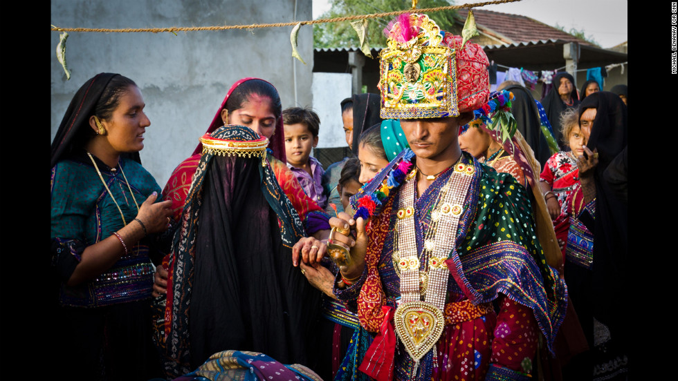 Groom Karanabhai Khambhalya arrives back at his home, in the village of Kharapasavariya, with his new wife, Rami. He will see her face for the first time later that night.