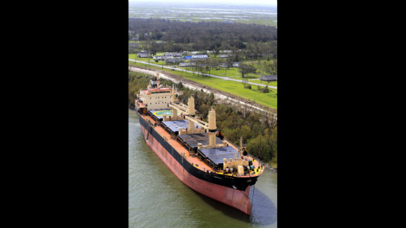The ship Arosa Basel sits grounded on the east bank of the Mississippi River in Plaquemines Parish, Louisiana, Friday.