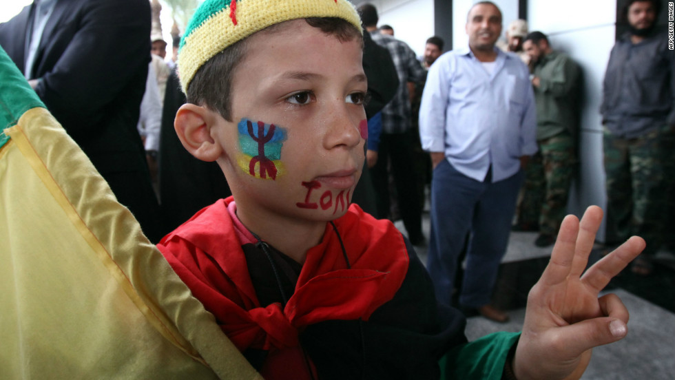A Berber boy, decorated in the image of the Amazigh flag, takes part in a protest outside government offices demanding recognition of Berber language and culture in Libya's new consitution.