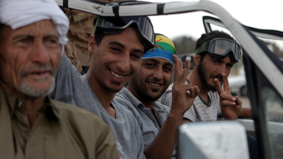 Berber rebels flash victory signs outside a Gadhafi compound in September 2011. Berbers fought fiercely against Gadhafi's forces during the Libyan revolution, driven by four decades of the suppression of their culture under the old regime.