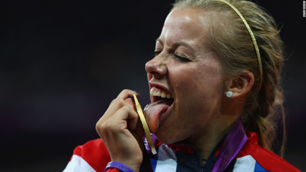 British gold medalist Hannah Cockroft poses on the podium during the victory ceremony in the Women's 100-meter T34 wheelchair race.