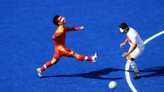 Chinese Zhoubin Wang, left, chases the ball during the men