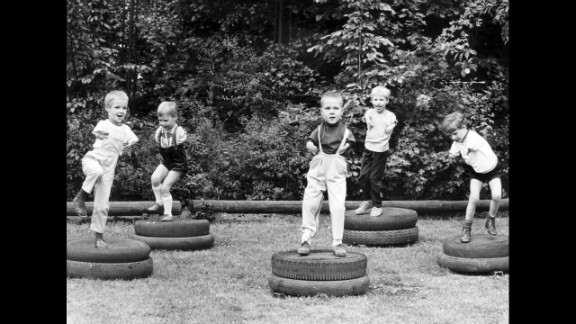 Children affected by Thalidomide jump on tires at the playground of the city run day care center for children suffering from dysmelia in Cologne, Germany, on March 24, 1968.