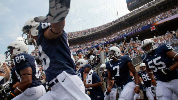 Members of the Penn State football team take the field to play their season opener against Ohio.
