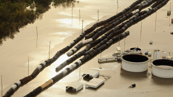 Oil containers and railroad cars sit in Isaac