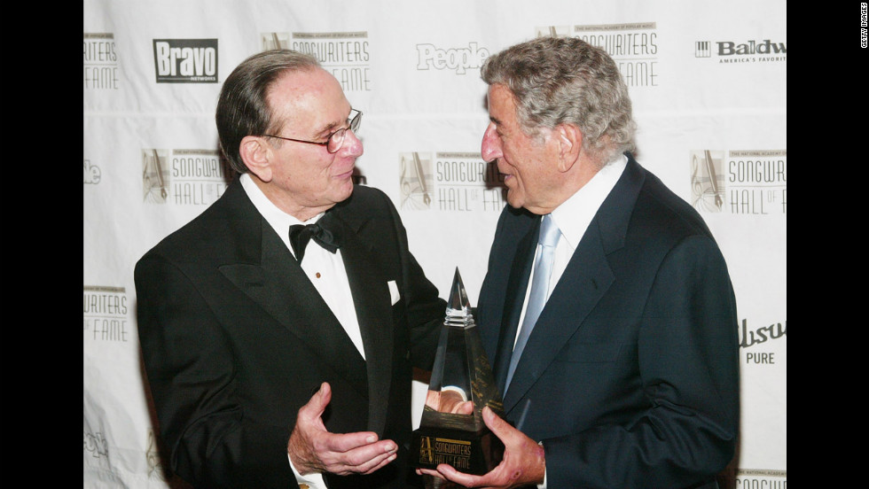 David, left, greets singer Tony Bennett after he was honored with the  Towering Performance Award  Tony at the Annual Songwriters Hall of Fame Awards ceremony in June 2003 New York City.