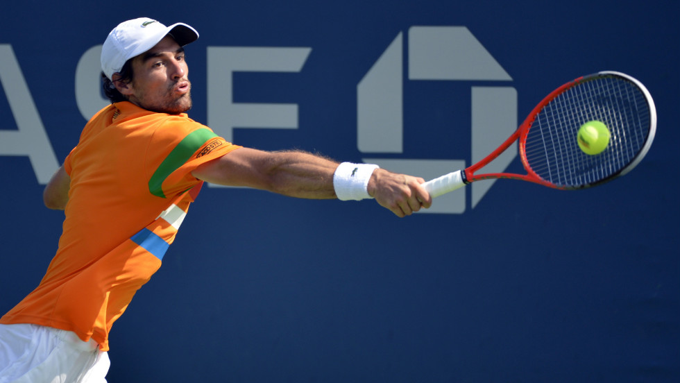 Frenchman Jeremy Chardy stretches to make a return against Slovakia's Martin Klizan.