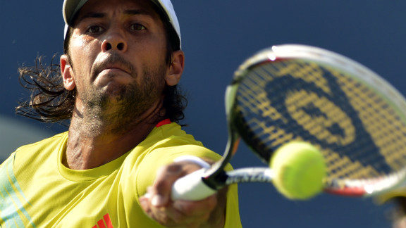 Fernando Verdasco of Spain returns a shot to top-ranked Roger Federer of Switzerland during their men
