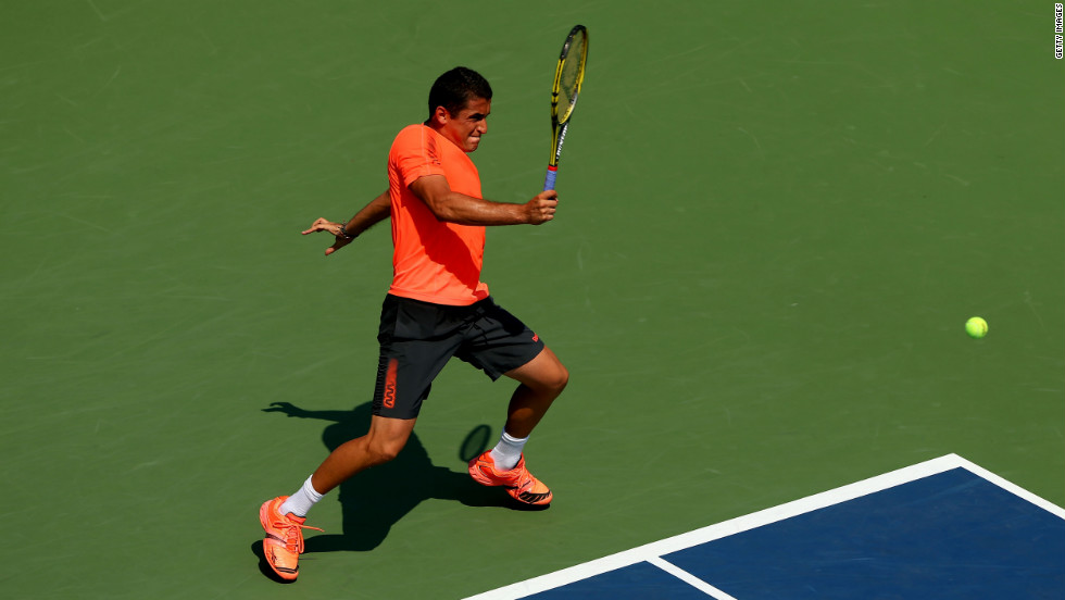 Spain's Nicolas Almagro returns a shot to Jack Sock of the United States.