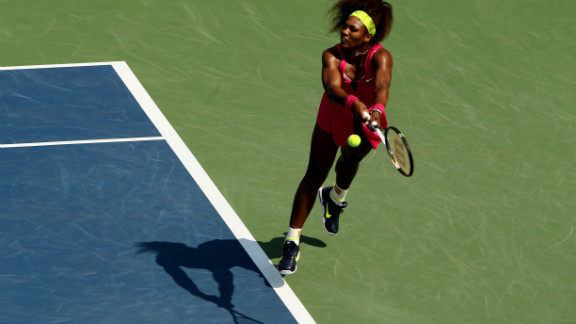 Serena Williams of the United States returns a shot against Russia