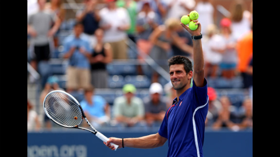 Novak Djokovic of Serbia waves to the crowd Sunday after winning his men