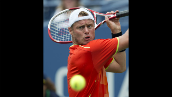 Lleyton Hewitt of Australia hits a return to David Ferrer of Spain during their men