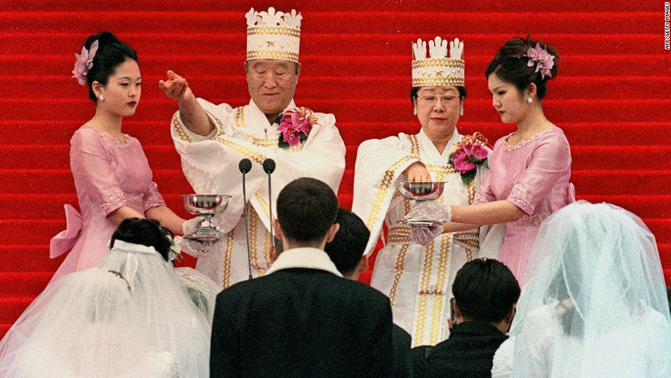 "Moon and his wife bless the brides and the grooms during the ceremony in Seoul. Followers of the Unification Church are sometimes referred to as ""Moonies."""