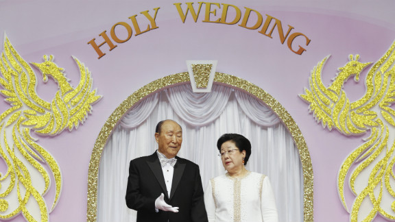 Moon and his wife oversee a mass wedding of 5,200 couples on March 24 in Gapyeong. The Unification Church performed its first mass wedding in 1961 with 33 couples.