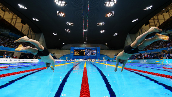 Daniel Fox, left, of Australia and Marc Evers of the Netherlands dive into the pool at the start of the men