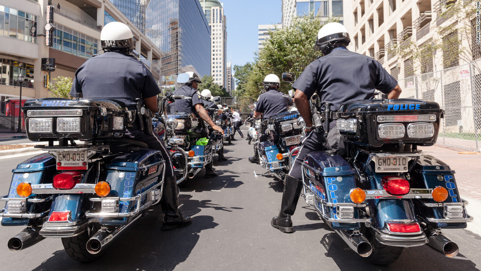 Motorcycle cops line up Sunday in the streets of uptown Charlotte.