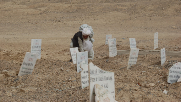A man visits a Taliban cemetery in the Arghandab district outside Kandahar city. The Taliban fighters who get killed in attacks are usually brought here by the International Committee of the Red Cross.