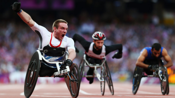 Mickey Bushell of Great Britain crosses the line to win gold in the men