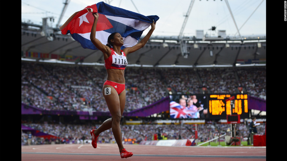 Cuba's Omara Durand celebrates after taking the gold medal in the women's 400-meter final.