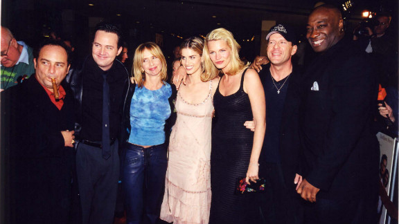 """In 2000, Duncan was cast in the crime comedy """"The Whole Nine Yards."""" He is seen at the premiere with co-stars, from left, Kevin Pollak, Matthew Perry, Rosanna Arquette, Amanda Peet, Natasha Henstridge and Bruce Willis."""