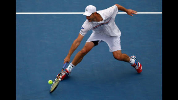 Roddick returns a shot to Fognini.