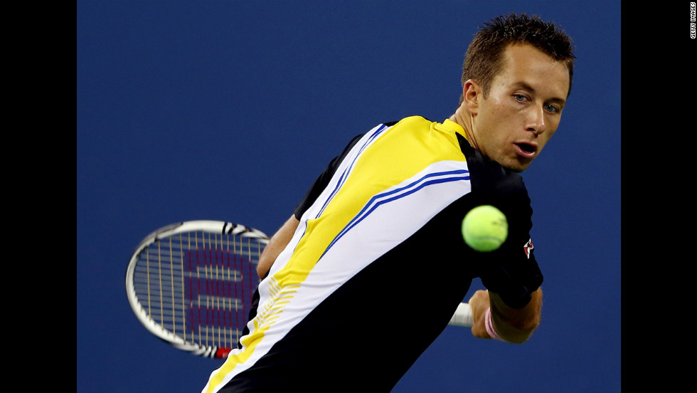 Philipp Kohlschreiber of Germany returns a shot to John Isner of the United States on Sunday.