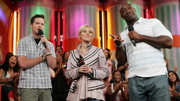 """Actress Scarlett Johansson and Duncan appear onstage together with host Damien Fahey of MTV's Total Request Live in 2005. Johansson and Duncan both had roles in the sci-fi film """"The Island"""" that year."""