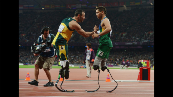 Oliveira is congratulated by Pistorius at the end of the men