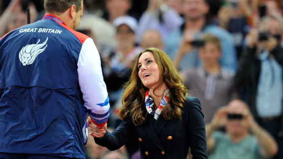 Catherine, Duchess of Cambridge, presents the gold medal to Aled Davies of Great Britain after he won the men