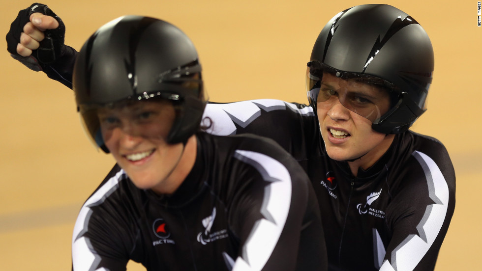 Laura Thompson, left, and Phillipa Gray of New Zealand celebrate winning a heat of the women's individual B pursuit track cycling event.