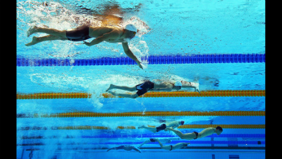 Swimmers compete in the men