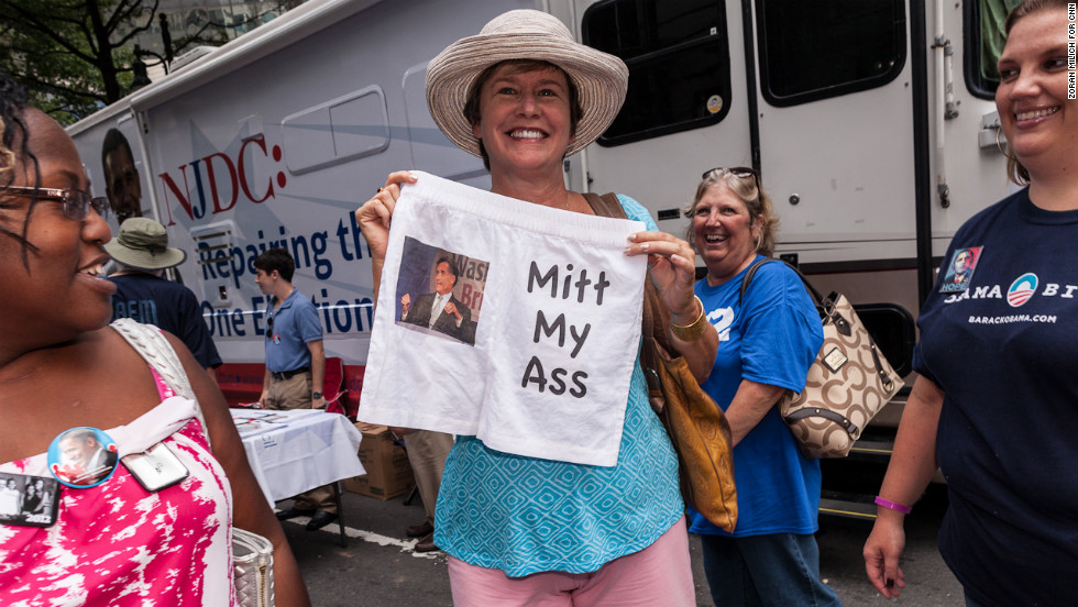 Lynn Hinkle of Missouri holds up a pair of shorts on Monday mocking Republican presidential candidate Mitt Romney.