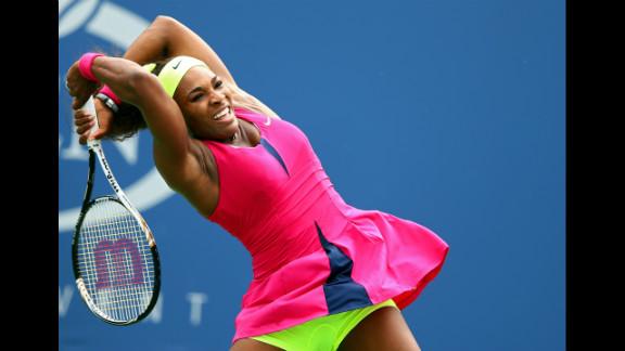 American Serena Williams returns a shot Monday.