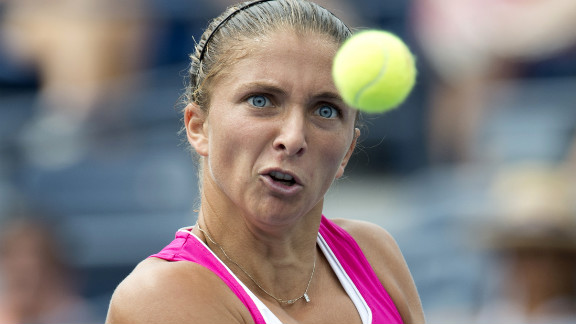 Sara Errani of Italy hits a return to Angelique Kerber of Germany during their women