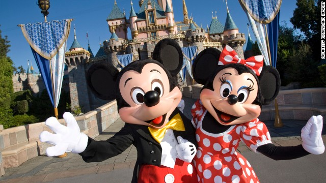 Mickey and Minnie Mouse in front of Sleeping Beauty Castle at Disneyland in Anaheim, California.