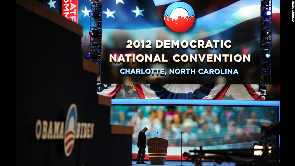 A worker checks the stage hours before the start of the convention on Tuesday.