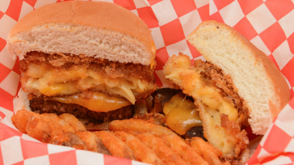"The State Fair of Texas features sliders. ""Three-cheese mac is baked until golden brown, battered in bread crumbs, deep-fried until crisp on the outside, warm and gooey on the inside,"" fair officials say. The concoction is then placed on a slider bun with a griddled beef patty."