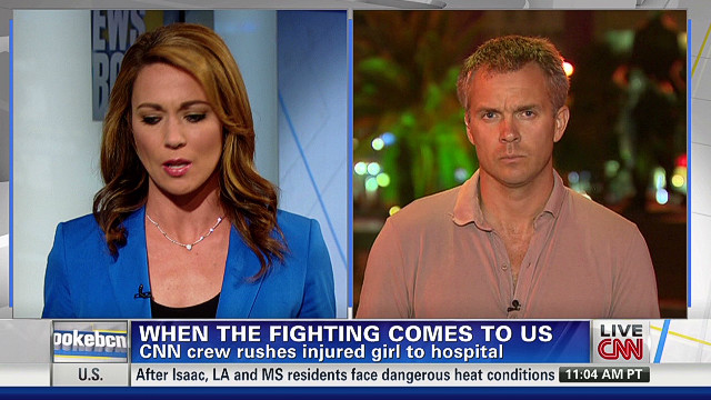 CNN crew helps injured child in Syria