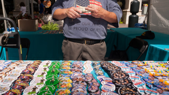 A man sells buttons supporting President Barack Obama on Monday.