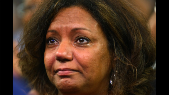 Dr. Lorrie Rickman Jones of Chicago cries as she watches Tuesday